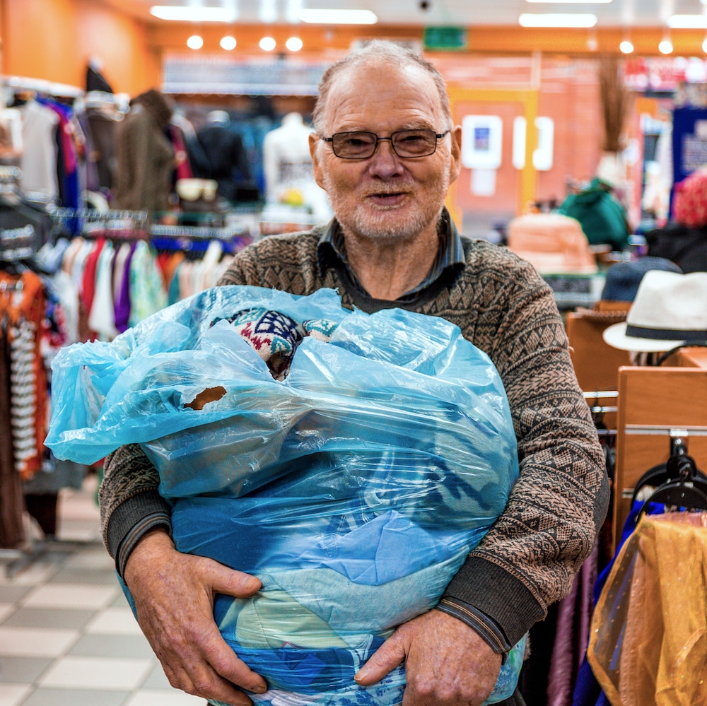 Volunteer John with bag of clothes